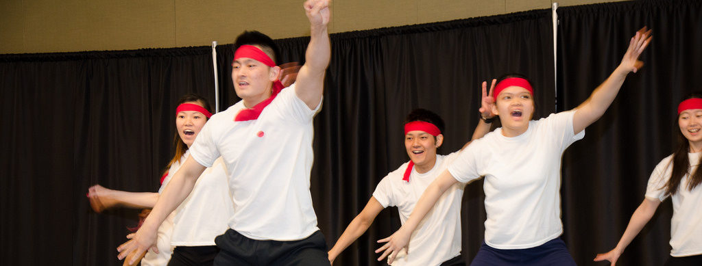 Students performing an international dance as part of a student activity.