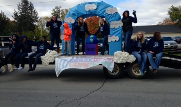 Students on a homecoming parade float.